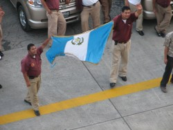 Goodbye Guatamala - Two Men Hold up Guatamala Flag.jpg