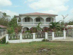 Nice house in Belize City on tour bus excursion.jpg