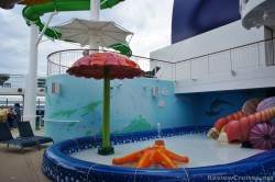 Sea star water feature and slide at Kid's Pool area of Norwegian Epic.jpg