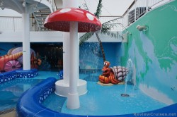 Water snail and mushroom water features at Norwegian Epic Kid's Pool area.jpg