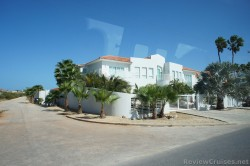 White large house with gates near ocean in Aruba.jpg