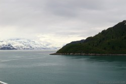 Glacier Bay snow covered mountains and darker hill.jpg