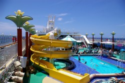 Twisting yellow slide on the Norwegian Pearl pool deck.jpg