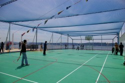 Norwegian Pearl Sports Court with Basketball Hoops & Net Covers.jpg