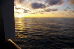 Sunset viewed from Carnival Pride Balcony Stateroom.jpg