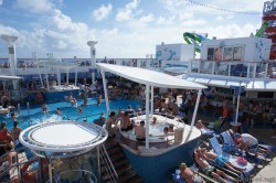 Crowd enjoying the sun & the hot tub at Pool area of NCL Getaway.jpg