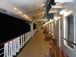 The Promenade deck at night on board the Grand Princess.jpg