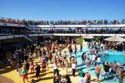 Vacationers dancing on the pool deck during the Carnival Breeze Sailaway Party.jpg