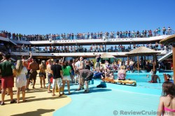 Carnival Breeze Cruise Director Butch Begovich gets the Sailaway Party started.jpg