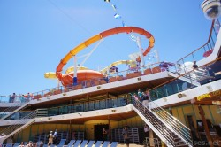 Looping orange water slide viewed from pool deck of Carnival Breeze.jpg