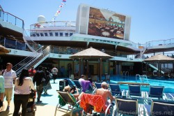 Carnival Breeze main pool with giant flat screen above.jpg