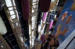 Elevators facing like ornament like decor overlooking Carnival Breeze atrium.jpg