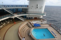 An outdoor pool at the Aft of the Golden Princess cruise ship.jpg