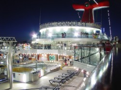 The Carnival Conquest Pool Deck at night.jpg
