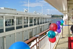 Colorful ballons hang on railings on embarkation day of Norwegian Gem.jpg