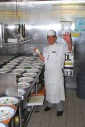 A chef preparing delicacies in a kitchen aboard the ms Rotterdam.jpg