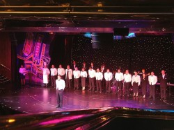 Celebrity Century ship officers on stage.jpg