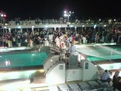 Celebrity Century pool party at night.jpg