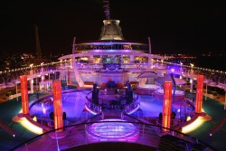 Independence of the Seas pool deck at night.jpg