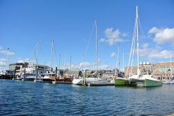 Catamaran and other boats docked at Newport Rhode Island.jpg
