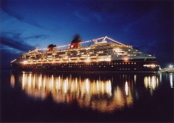 The Disney Magic cruise ship lights up at night.jpg