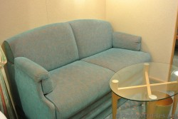 Sofa bed & coffee table inside Interior Cabin of Royal Caribbean Explorer of the Seas.jpg