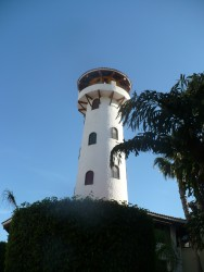 White tower restaurant building at the Cabo pier area.JPG
