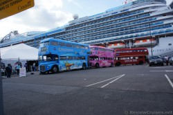 Three colorful double decker buses at cruise terminal St John.jpg