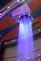 Blue-lit Water falling out Rising Tide bar Oasis of the Seas.jpg