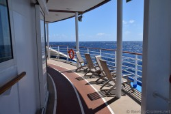 Teak Lounge Chairs on back of cruise ship deck 5 jogging track.jpg