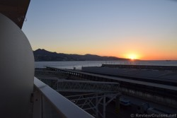 Sunrise over Malaga seen from the Port.jpg