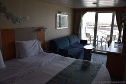 Queen Bed and Sleeper Sofa of Oasis of the Seas Balcony Stateroom.jpg