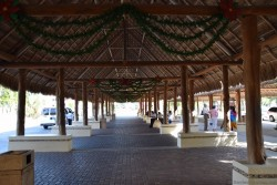 Christmas green decorated wreaths hanging on exit pavillion of Puerta Maya Port Cozumel.jpg