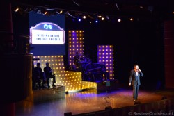 Kelvin Joy Emerald Princess Cruise Director Welcome Guests in Theater.jpg
