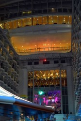 Colorful Lights and Honeycomb of Balconies Overlooking the Boardwalk of Oasis of the Seas at Night.jpg
