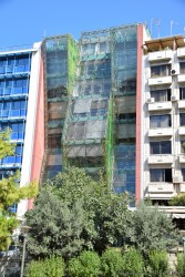 Funky Apartment Building with Gree Slanted Glass in Piraeus Greece.jpg