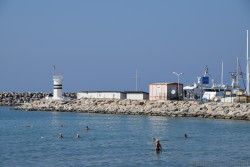 People Swimming in the Waters near Kusadasi Beach.jpg