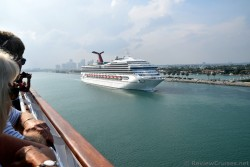 People on Cruise Ship watching Carnival Victory Sail Past.jpg