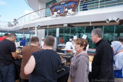People waiting for BBQ on pool deck Royal Caribbean Explorer of the Seas.jpg