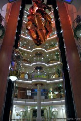 View of balconies overlooking atrium + copper statue aboard Royal Caribbean Explorer of the Seas.jpg
