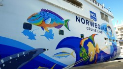 Norwegian Escape Hull Art of Colorful Fish at Back of Ship