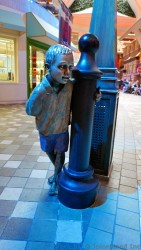 Statue of a Boy next to a Pole at Royal Promenade Allure of the Seas