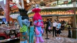 Trolls Characters Branch & Poppy Pose for Photo with Young Guest on Royal Caribbean Allure of the Seas