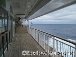 Wooden decks outside the automatic doors to atrium of deck 7 aboard Norwegian Dawn.jpg