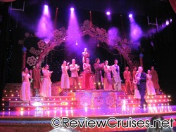 Bollywood show performers clap on stage aboard the Norwegian Dawn.jpg
