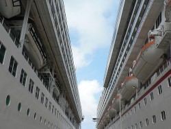 The NCL Sun Docked next to a Carnival Cruise Ship at Costa Maya Mexico.jpg