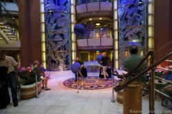 Jugglers perform at Piazza level of Caribbean Princess.jpg
