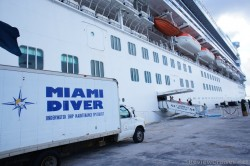 Miami Diver Underwater Ship Maintenance Specialist truck tending to Caribbean Princess docked at Willemstad Curacao.jpg